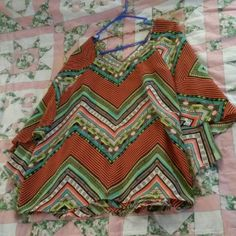 NWOT. Beautiful Aztec Tunic with Cape New.  Gorgeous Aztec Tunic with a built in Cape. Pics show front then back then cape. About 30 inches from top to bottom. Size  18/20 Tops Tunics