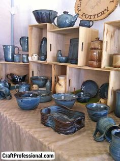 displaying pottery craft show | Pottery booth with natural colors.