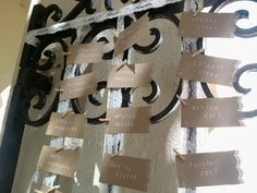 Angelica's craft paper escort cards with handstamped names and mini clothespins. I attached to lace on an iron gate at St. Vincent School for Boys.