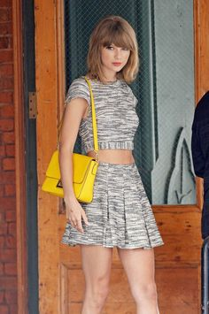 Epic Beauty Taylor Swift Heads To Photo Shoot In Grey And White Skirt, Pink Heels And A Male Friend - http://oceanup.com/2014/07/24/epic-beauty-taylor-swift-heads-to-photo-shoot-in-grey-and-white-skirt-pink-heels-and-a-male-friend/