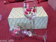 Price $15.00 - Handpainted Roses wine glass Gift set of 2     These wine glasses aregorgeously hand-painted with beautiful pink roses and vibrant green leaves. Buy a set of two for an intimate toast - or buy more for a special occasion or holiday. These lovely glasses would brighten up any table, and definitely wi...
