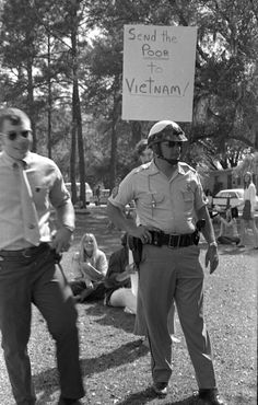 John Buckley, View of a Florida State University student holding U.S. flag on Landis Green during a pro-American rally - Tallahassee, Florida.  State Archives of Florida, Florida Memory, http://floridamemory.com/items/show/130617  The march was sponsored by the FSU Committee on Responsible Student Action (described as an offshoot of the Young Republicans) and organized by Florida State University senior Pat O'Conner.