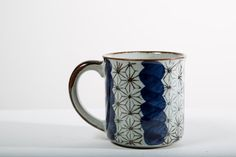 Warm up this winter with some cider, hot chocolate or coffee in this super cute mid century ceramic mug! Made in Japan, makers mark visible on