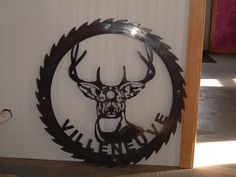 Custom 48 inch saw blade sign.  www.custommetaldesigns.webs.com