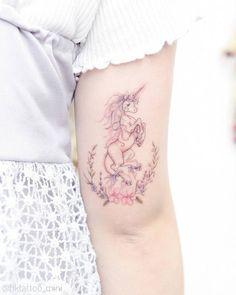 Lovely Unicorn Tattoo Above Elbow