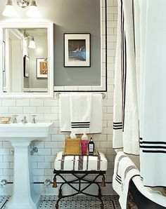 Love this simple black and white bathroom. The towels, the tub, the style....perfect for my house