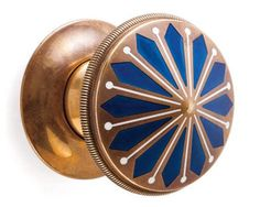 Round brass knob with blue inlay. Luxe would be the appropriate word.