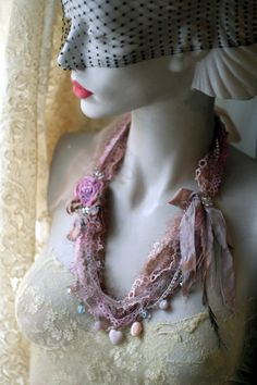 Shabby chic and playful necklace is constructed from various vintage and contemporary textiles and findings- antique handmade needle lace trim,