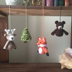 Rustic and Woodsy Baby Mobile - A deer, tree, fox and a bear, hand crocheted by me. I take pride in the details, each creation is created with time and love.  This simplistic design adds a stylish touch to any nursery.  Branch is hand picked from the woods of British Columbia, Canada and is coated with a non-toxic finish. Mobile is approximately 16 wide and 14 long, measuring from the branch to the bottom of the woodland friends.  I can also do other animals upon request.