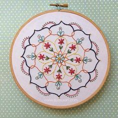 Here we have my very first original hand embroidered mandala design! The others Ive done in the past have been from purchased patterns. I really enjoyed creating this. I think there will be more soon! Embroidery hoop art by Suosaari on Etsy.