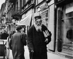 A rabbi. Warsaw, 1938 . The books are his companions and are part and parcel of his life. They are treated with respect and veneration. For the rabbi, the books are inexhaustible resource of knowledge.
