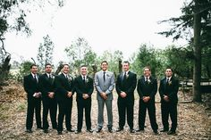 Black suits for groomsmen  light grey for the groom. Really spotlights the groom!