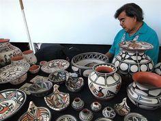 Robert Tenorio displays his Santa Domingo Pueblo pottery at the Santa Fe Indian Market in Santa Fe, New Mexico, August 20, 2011. REUTERS/Mar...