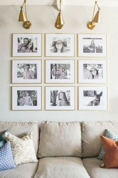 Creating a Grid Style Gallery Wall with these easy tips and tricks. Brass matted picture frames, brass swing arm sconces turned into a gallery wall creates the perfect backdrop for our sofa. This tutorial allows you to create a gallery wall minus the dreaded holes!