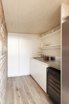 scullery with stainless bench top
