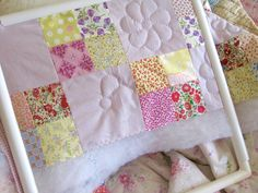 http://quiltingstories.blogspot.com/2015/04/hand-quilting-liberty-four-patch-hoop-wisteria-lilac.html