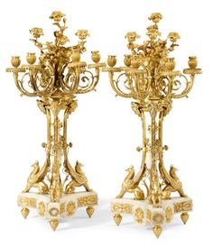 A pair of Louis XVI style gilt bronze and marble ten light candelabra <BR />late 19th century