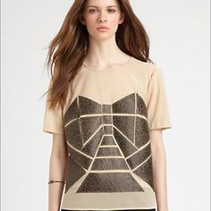 Fashion Star EXCLUSIVELY AT SAKS Distressed geometric leather appliqués add depth to this semi-sheer nude tee, creating a textually unique design. Brand new  Jewelneck Short sleeves Leather appliqués Back button closure Partially lined inside camisole  About 21″ from shoulder to hem Nylon/spandex Dry clean  NOTE AS PICTURED : BUTTONS FEEL OFF THE BACK Fashion Star Tops