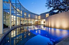 Preston Hollow saucer house 10M The home allows for easy transitioning between areas thanks to recessed doors and a sliding panel that bridges the interior entertaining areas with a central courtyard.
