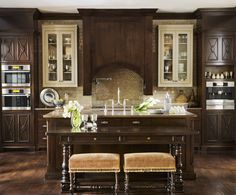 This innovative, functional and beautiful kitchen includes custom cabinetry, a large island abutted by a 19th-century English table, a built-in Miele coffee system, and open shelves lined with Vietri pottery and Match pewter.