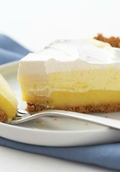 Triple-Layer Lemon Pie – Three layers—fluffy, creamy and cool—come to make this perfect no-bake dessert. It's an easy summer recipe, ready for the refrigerator in just 15 minutes time. Lemon Pie Recipe, Lemon Recipes, Pie Recipes, Baking Recipes, Sweet Recipes, Dessert Recipes, No Bake Lemon Pie, Recipies, Lemon Desserts