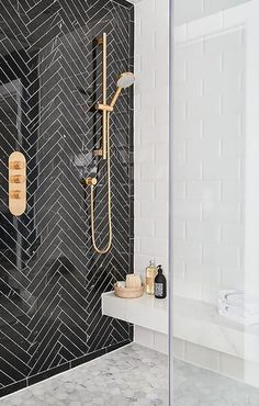 I love these black herringbone tiles with the metro wall tiles and honeycomb tiled floor. The combination of monochrome and brass works so well.