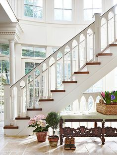 This staircase's eye-catching railing is reminiscent of Gothic architecture - Traditional Home® / Design: Jack Fhillips / Photo: Robert Brantley