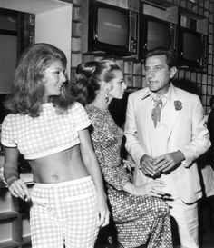 Baroness Fiona Von Thyssen (former model Fiona Campbell-Walter) in Courréges attends the 1967 Venice Film Festival Ball with Capucine (in Pucci) and Italian film director and writer Gualtiero Jacopetti.
