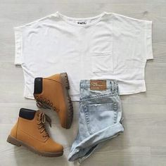 Blue shorts white shirt and a pair of boots are never a bad idea
