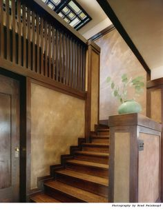 This beautiful wood staircase in Frank Lloyd Wright's Westcott House was restored by The Durable Restoration Company.