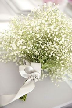 Do you like the baby's breath for a bouquet to tie into what we are doing for the tables?