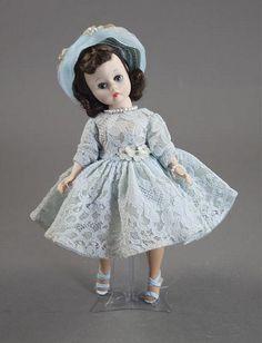 Cissette in an original blue lace dress