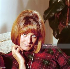 1964 English actress Vanessa Redgrave posed wearing a tartan patterned top in 1964.