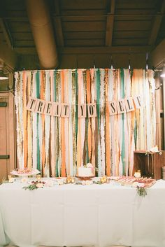 Use colorful streamers as a backdrop to show off a funny saying. Photo by onelove photography  via Style Me Pretty