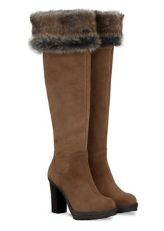 You could spend over $200.00 for these gorgeous fur-topped boots but instead, opt for a pair of Top of the Boot faux fur boot toppers.  They're only $39.99!  www.mytopoftheboot.com