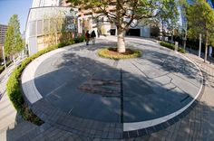 "Project: Iidabashi Plano  Designers: Earthscape  Location: Fujimi Chiyoda-ku Tokyo, Japan    The ""Time Tree"" offers an overview of the history of the region from the Edo period to the present, and, as a symbol of Proud Tower residences in Fujimi, Chiyoda, it provides the opportunity to discover various connections across time. And at the root of the location's history, the central camphor tree grows into the future."