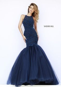 Sherri Hill 32095 high neck mermaid gown with a fully beaded bodice and full tulle skirt.