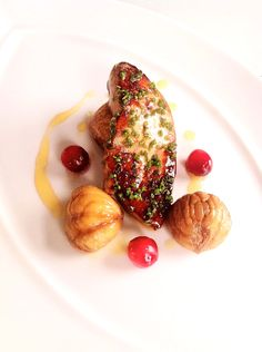 Foie gras with chestnuts, poached cranberries, and a drizzle of chestnut honey
