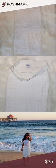 White BEBE pencil skirt Only worn once. Beautiful white pencil skirt. It stretches and has textured, very flattering. bebe Skirts Pencil