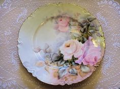 A rare set of seven gorgeous hand painted antique Haviland Limoges France floral plates, signed by the artist