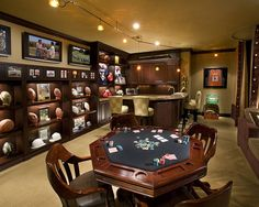 Memorabilia is displayed in custom designed cabinetry with Zenon lighting. Magnetic acrylic panels at the top of the display unit allow baseball cards, game tickets, and photos to be accessed and changed.    Featured: PRIME Living Magazine September 2012 Issue