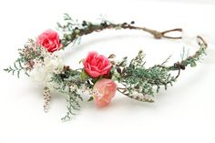 Pretty headpiece.  I think more muted color pastel roses (especially in peach tones) would be even more pretty... and a little less greenery (is that a word?).