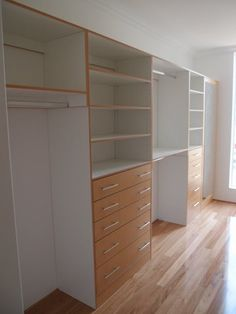 white internal with timber trim and window at the end. keeps it light and airy