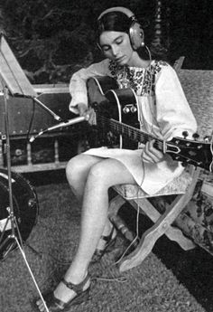 Emmylou Harris. Oh Emmylou,with her beautiful sweet/sorrowful voice