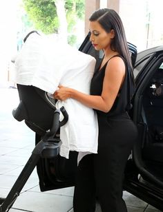 Kim Kardashian Photos Photos - Reality star and new mom Kim Kardashian takes her daughter North to see her doctor in Beverly Hills, California on June 24, 2014. North had her first birthday party this past weekend! - Kim Kardashian Takes North to the Doctor