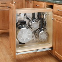 Add this pullout organizer shelf to your kitchen cabinet to eliminate the clutter of bulky pots and pans.