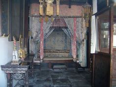Bedroom in the Last Emperor's chambers in the Forbidden City - note the number of silk bedcovers