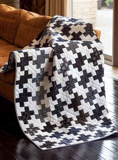 """We love two-color quilts! This one, Adam's Rib, by Tony Jacobson, was fashioned after a robe that Katherine Hepburn wore in the 1949 movie by the same name. She starred opposite Spencer Tracy in classic """"battle of the sexes"""" movie, hence the stark black and white color scheme. Pretty cool, right?"""