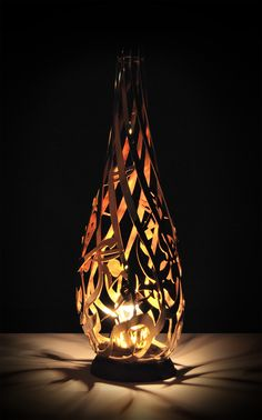 Lamp made of an Oak stand with gold-plated lacquered Arabic calligraphy. .أذكورني أذكركم اشكروا لي ولا تكفرون