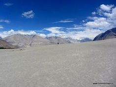Pass over the highest motorable road in the world to meet severely blue skies and swirling sand dunes in Nubra Valley. A Solomon Says Travel review